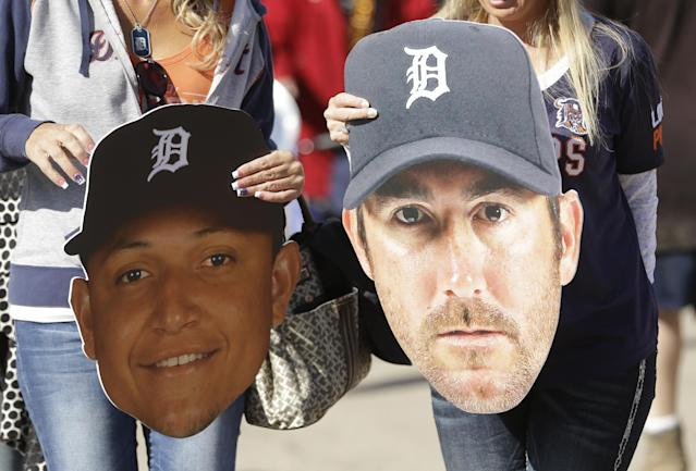 Baseball fans hold up cutouts of Detroit Tigers first baseman Miguel Cabrera, left, and pitcher Justin Verlander before the baseball game between the Tigers and the Kansas City Royals in Detroit, Monday, March 31, 2014. (AP Photo/Carlos Osorio)