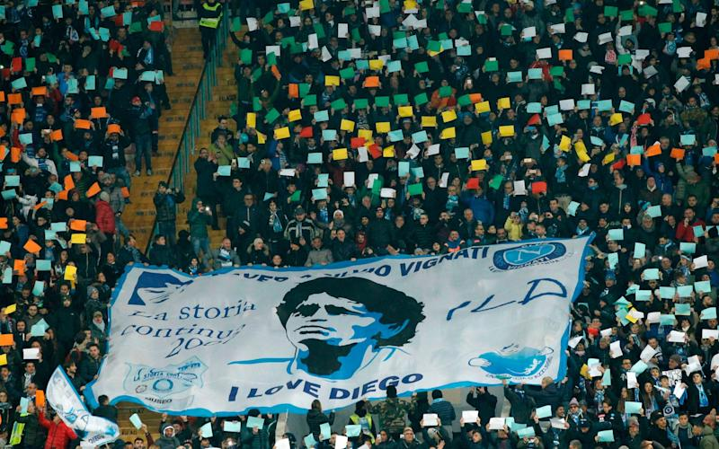 Napoli's fans deploy a giant banner showing Argentinian football star Diego Maradona before the Italian Serie A football match Napoli vs Juventus - CARLO HERMANN/AFP
