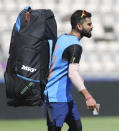 India's captain Virat Kohli carries a glass of ice water to relieve pain in his right thumb after hurting it during a training session ahead of their Cricket World Cup match against South Africa at Ageas Bowl in Southampton, England, Saturday, June 1, 2019. (AP Photo/Aijaz Rahi)