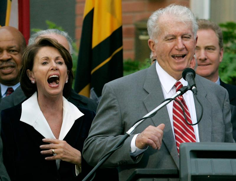 Speaker of the House Nancy Pelosi, D-Calif., left, laughs as her brother Thomas D' Alesandro III, right, makes a joke as he introduces her husband Paul, during a street renaming ceremony in her behalf, in Baltimore, Jan. 5, 2007.