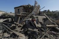 A view shows the ruins of a building following recent shelling during a military conflict over the breakaway region of Nagorno-Karabakh, in Stepanakert