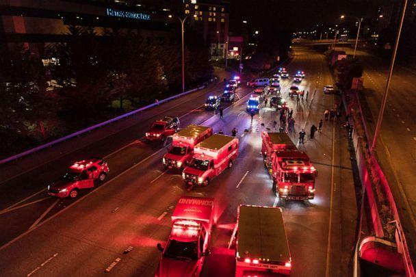 PHOTO: Emergency personnel work at the site where a driver sped through a protest-related closure on the Interstate 5 freeway in Seattle, July 4, 2020. (James Anderson/AP)