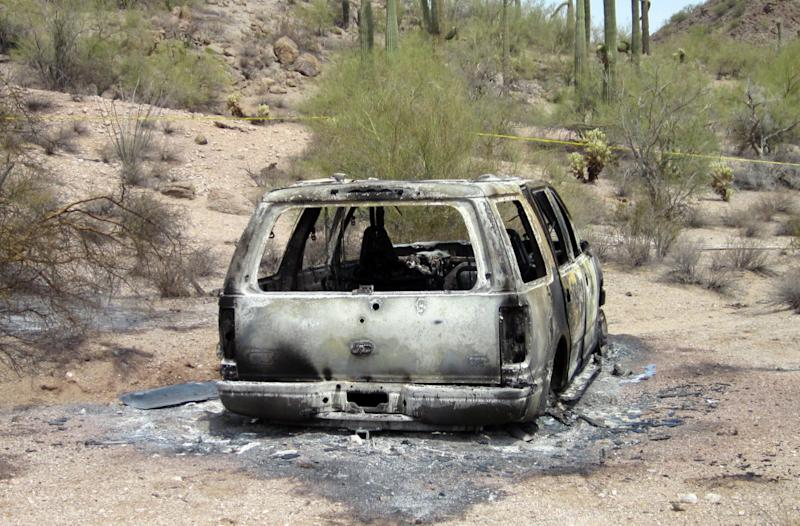 This image provided Saturday June 2, 2012, by the Pinal County Sheriff's Office, shows the vehicle where five dead bodies burned  were found inside in Pinal County's Vekol Valley area, west of Casa Grande, N.M. Authorities say the inncident may be drug related. (AP Photo/ Pinal County Sheriff's Office)