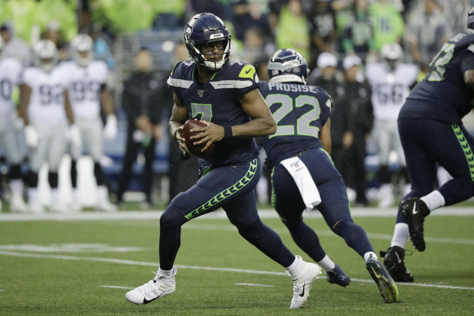 Seattle Seahawks quarterback Geno Smith drops back during the first half of the team's NFL football preseason game against the Oakland Raiders, Thursday, Aug. 29, 2019, in Seattle. (AP Photo/Elaine Thompson)
