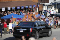 FILE - In this June 5, 2020 file photo, supporters of President Donald Trump cheer as the motorcade passes during Trump's visit to Guilford, Maine. Trump visited Puritan Medical Products, one of the top two makers of testing swabs in the world. Nebraska and Maine aren't exactly swing states in the race to pick the next president, but each one has something to offer next month that could give them a huge amount of sway: a single electoral vote. (AP Photo/Robert F. Bukaty, File)