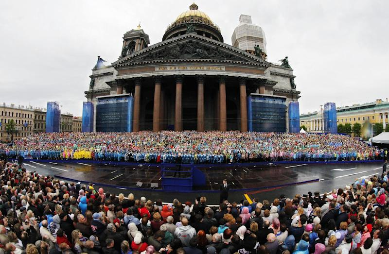 Crowds gather to watch the 4,335 strong choir of St. Petersburg perform a mass choir program near the city's famed St. Isaac's Cathedral to honor the city's 310th anniversary and aimming to set the Guinness wold record, in St.Petersburg, Russia, Sunday, May 26, 2013. (AP Photo/Dmitry Lovetsky)