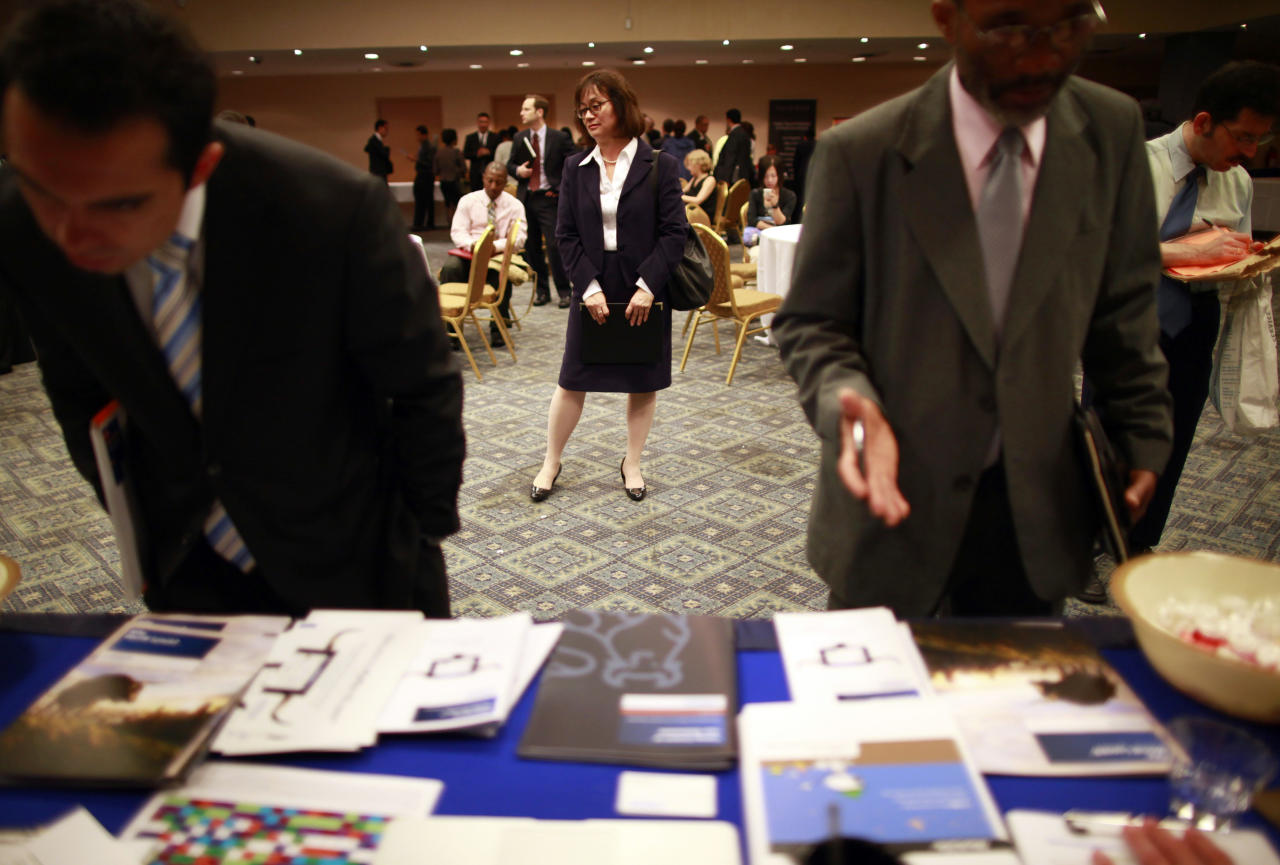 People participate in a job fair in New York June 11, 2012. REUTERS/Eric Thayer (UNITED STATES - Tags: BUSINESS EMPLOYMENT)
