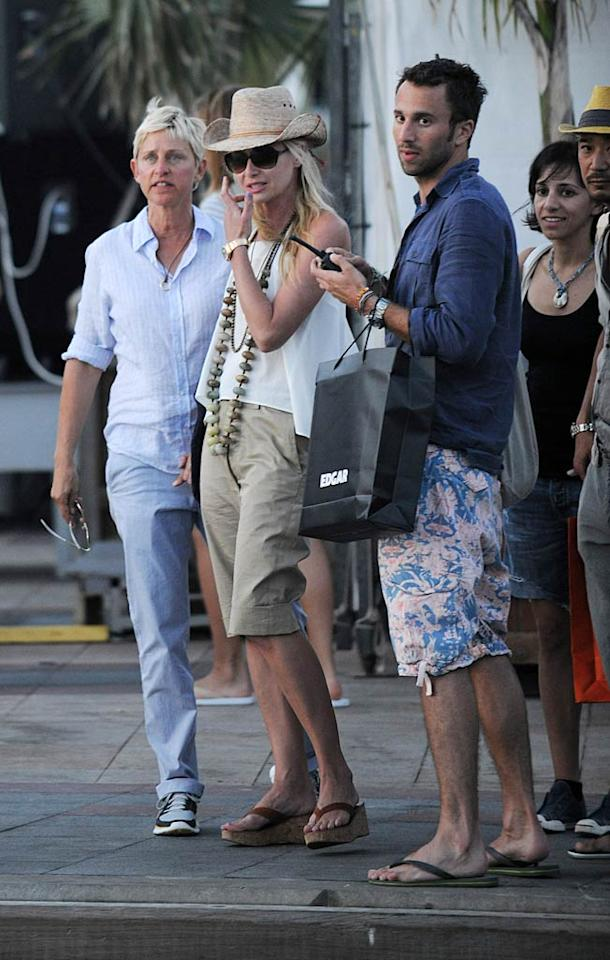 """Ellen DeGeneres and Portia De Rossi checked out the local scene in St. Barts before heading back to their yacht Tuesday evening. It's a small island. Do you think the pair caught up with Diddy? <a href=""""http://www.splashnewsonline.com"""" target=""""new"""">Splash News</a> - December 28, 2010"""