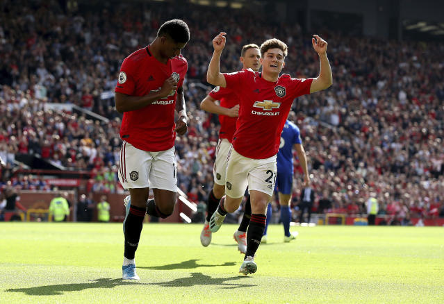 Manchester United's Marcus Rashford, left, celebrates scoring his side's first goal of the game from the penalty spot during the English Premier League soccer match between Manchester United and Leicester City at Old Trafford Stadium, Manchester England. Saturday, Sept. 14 2019 (Martin Rickett/PA via AP)