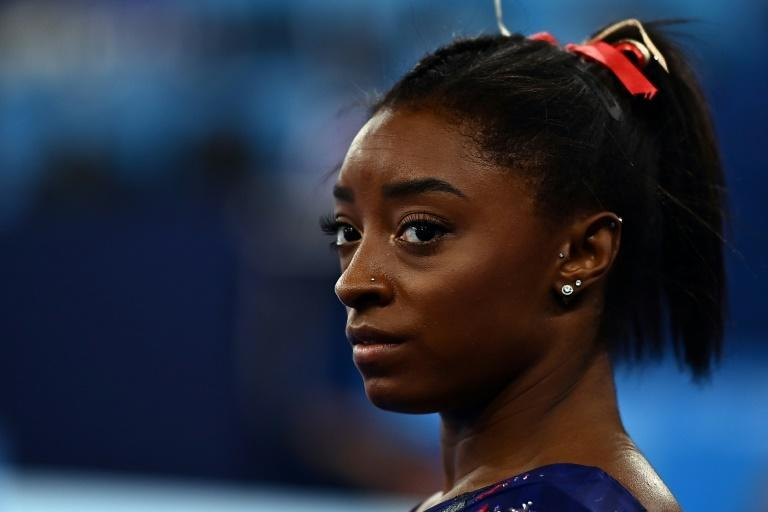 Simone Biles is feeling the pressure as she seeks to lead the USA to the Olympic women's team title in gymnastics