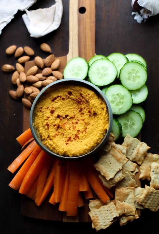 """<p>Carrots can make great apps, too, especially in hummus form. You're going to love these warm, spicy flavors.</p> <p><strong>Get the recipe: </strong><a href=""""https://www.asaucykitchen.com/roasted-carrot-hummus/"""" class=""""link rapid-noclick-resp"""" rel=""""nofollow noopener"""" target=""""_blank"""" data-ylk=""""slk:roasted carrot hummus"""">roasted carrot hummus</a></p>"""