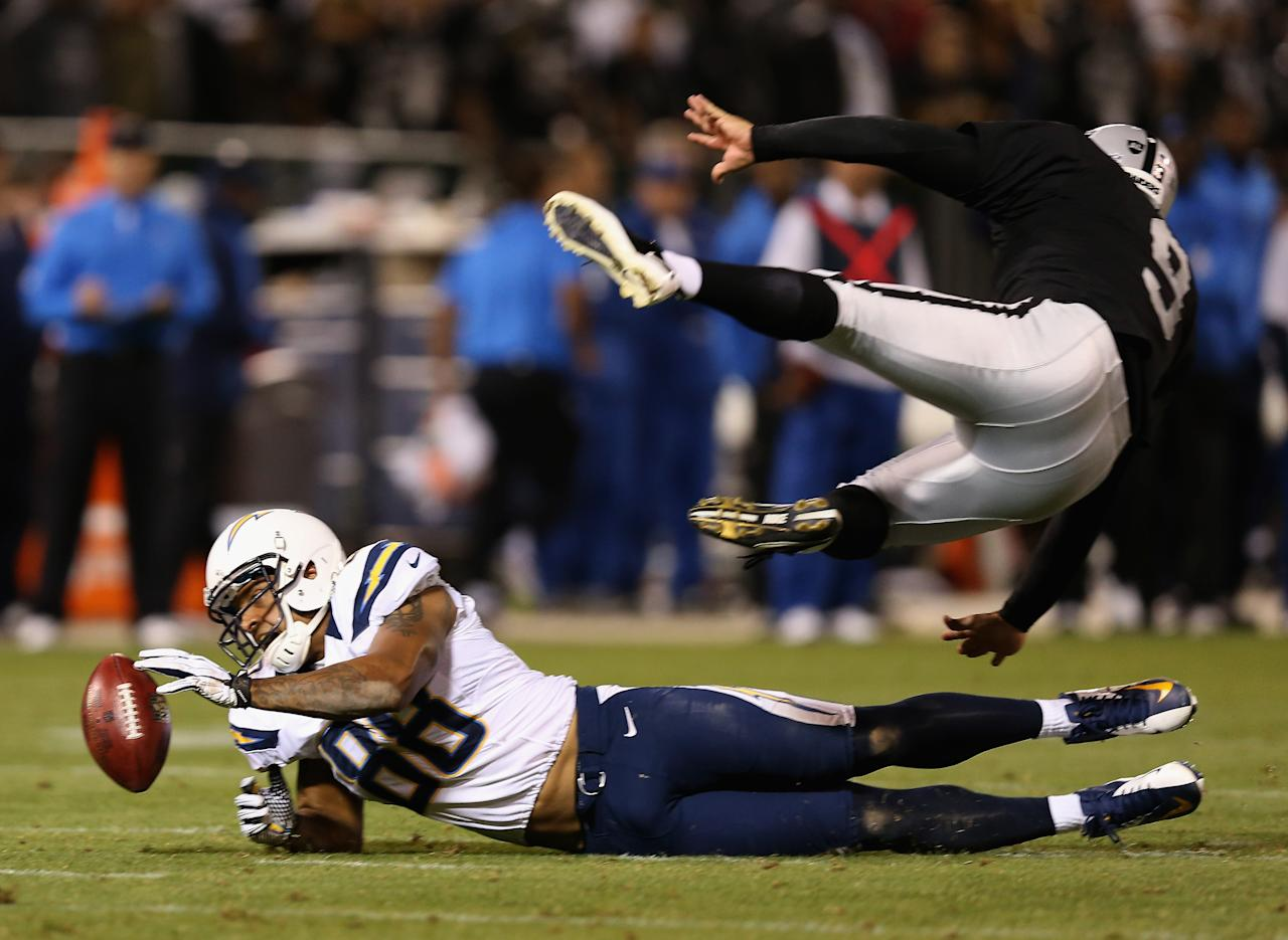 OAKLAND, CA - SEPTEMBER 10: Dante Rosario #88 of the San Diego Chargers blocks a punt attempt by Shane Lechler #9 of the Oakland Raiders during their season opener at Oakland-Alameda County Coliseum on September 10, 2012 in Oakland, California.  (Photo by Ezra Shaw/Getty Images)