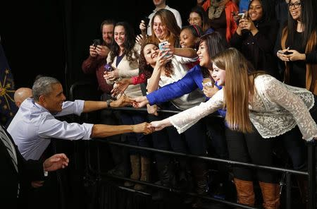 U.S. President Barack Obama shakes hands with students after speaking about his plan for free community college education and middle class economics during a visit Ivy Tech Community College in Indianapolis, Indiana, February 6, 2015. REUTERS/Kevin Lamarque