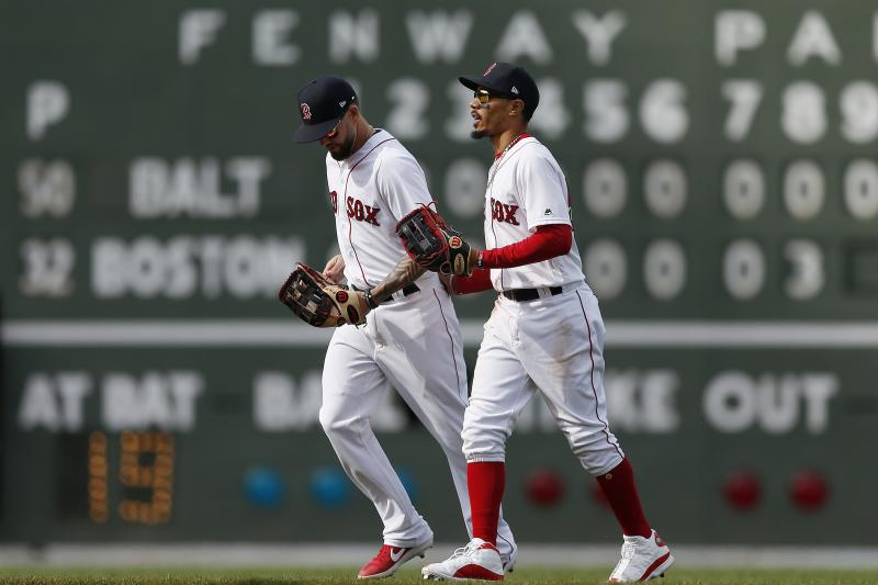 Boston Red Sox's Mookie Betts, right, and Blake Swihart head in after defeating the Baltimore Orioles during a baseball game in Boston, Sunday, April 14, 2019. (AP Photo/Michael Dwyer)