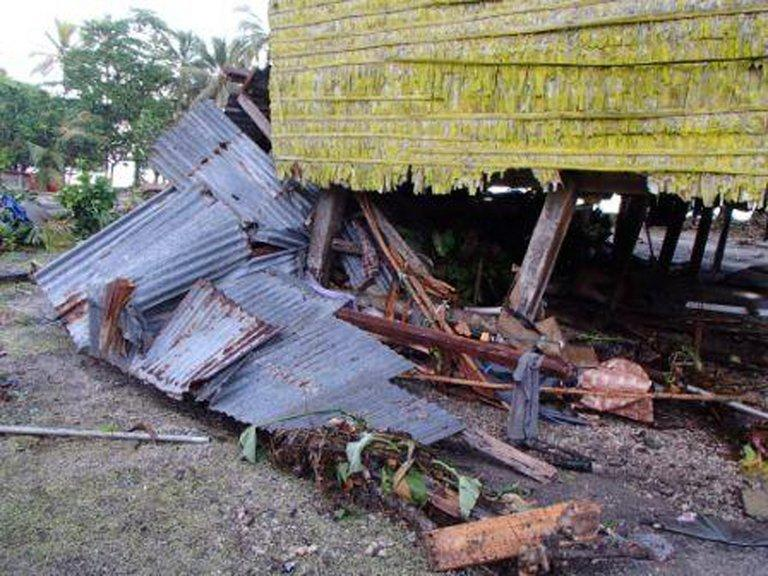 """This photo, taken on February 7, 2013, by World Vision, shows damage to a house in the village of Louva, caused by a tsunami in the Santa Cruz Islands region of the Solomons Islands. Relief workers scrambled to reach quake-ravaged villages in the Solomons on Saturday, with """"unusual seismic activity"""" sighted as strong aftershocks continued to jolt the remote Pacific region"""