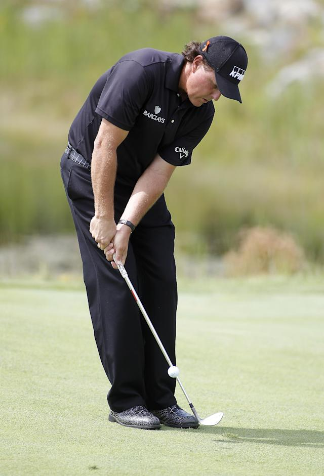 Phil Mickelson chips onto the second green during the first round of the Deutsche Bank Championship golf tournament in Norton, Mass., Friday, Aug. 29, 2014. (AP Photo/Stew Milne)