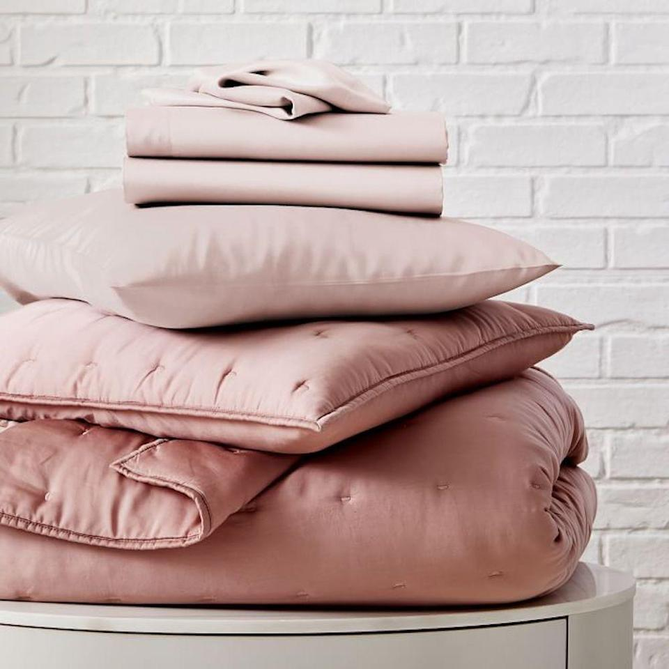 """<p><strong>TENCEL</strong></p><p>westelm.com</p><p><strong>$519.00</strong></p><p><a href=""""https://go.redirectingat.com?id=74968X1596630&url=https%3A%2F%2Fwww.westelm.com%2Fproducts%2Ftencel-crescent-stitch-quilt-bedding-set-adobe-rose-t5538&sref=https%3A%2F%2Fwww.bestproducts.com%2Fhome%2Fg34579398%2Fbest-bedding-bundles%2F"""" rel=""""nofollow noopener"""" target=""""_blank"""" data-ylk=""""slk:Shop Now"""" class=""""link rapid-noclick-resp"""">Shop Now</a></p><p>If you're looking for a pop of delicate color, this Tencel bedding bundle might be exactly what you need. Thought it's a little on the pricier side, you get a fitted sheet, a flat sheet, two pillowcases, two shams AND <a href=""""https://www.bestproducts.com/home/decor/g1685/bed-quilts-coverlets/"""" rel=""""nofollow noopener"""" target=""""_blank"""" data-ylk=""""slk:a quilt that's perfect for the colder months"""" class=""""link rapid-noclick-resp"""">a quilt that's perfect for the colder months</a>. You also have the option of buying the bedding bundle in silver and white, but this pink color is my favorite.</p>"""