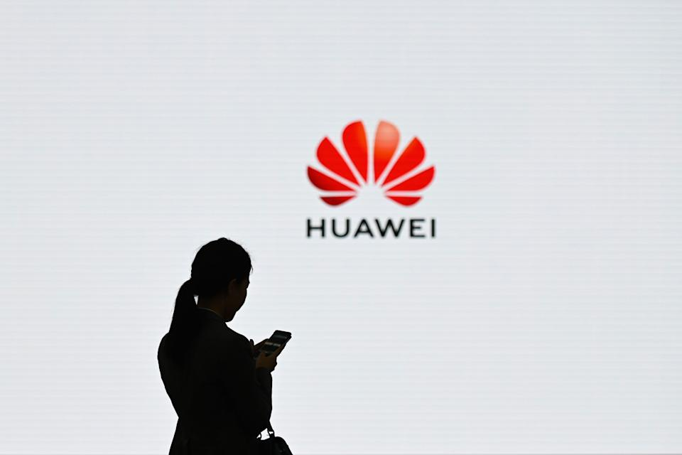 A staff member of Huawei uses her mobile phone at the Huawei Digital Transformation Showcase in Shenzhen, in China's Guangdong province, on March 6, 2019. (Photo: Wang Zhao/AFP/Getty Images)