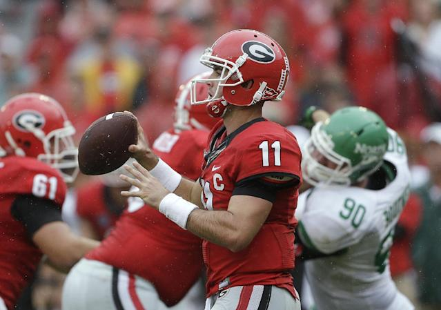 Georgia quarterback Aaron Murray (11) looks for an open receiver in the second half of an NCAA college football game against North Texas on Saturday, Sept. 21, 2013, in Athens, Ga. Georgia won 45-21. (AP Photo/John Bazemore)