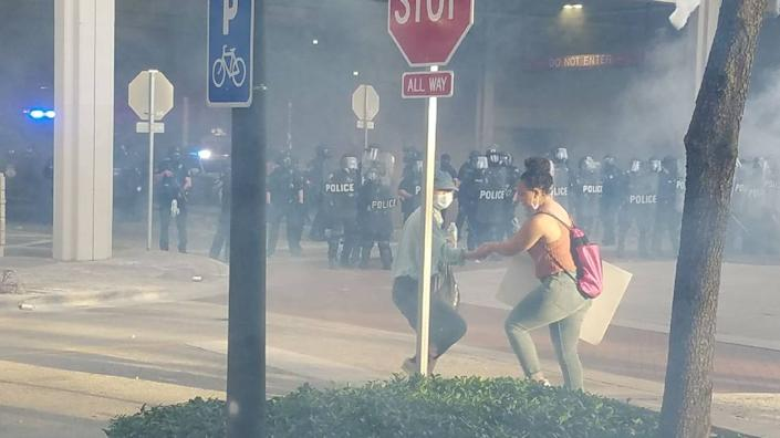 LaToya Ratlieff was being led away from tear gas by another marcher at an anti-police brutality protest in Fort Lauderdale May 31. Moments after this photo was taken a police officer shot her in the face with a foam rubber bullet, fracturing her right eye socket.