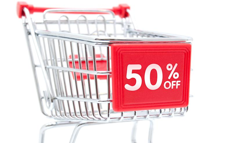 "A shopping trolley with a sign saying ""50 per cent off""."