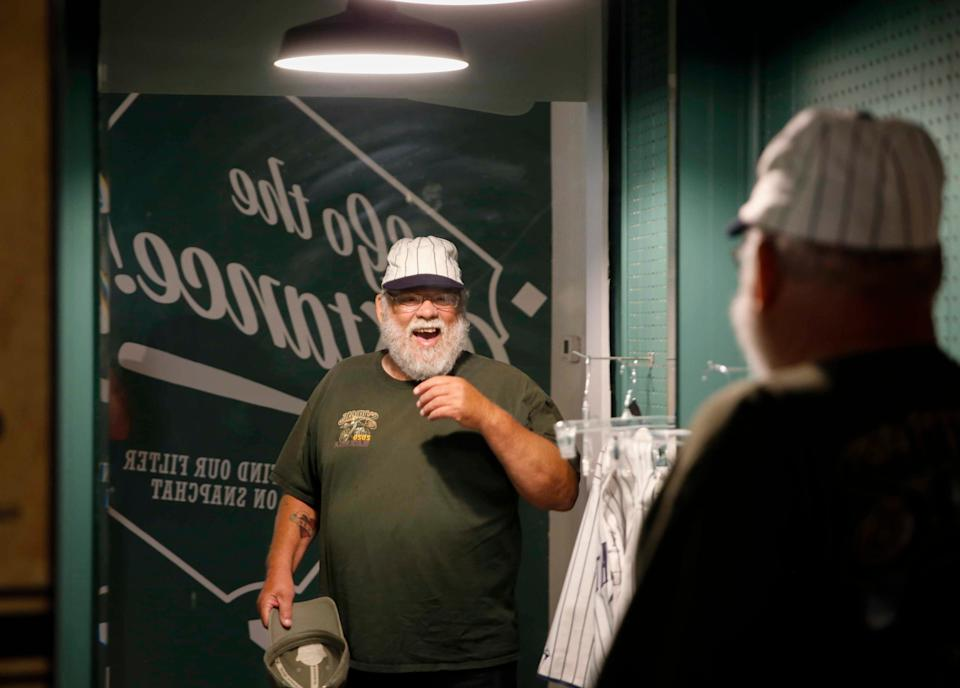 Ron Rawlings of Omaha tries on an old baseball hat while visiting the Field of Dreams museum in Dyersville on Thursday, Aug. 5, 2021. The museum has seen increased popularity in recent weeks due to an upcoming Major League Baseball game between the Chicago White Sox and the New York Yankees.