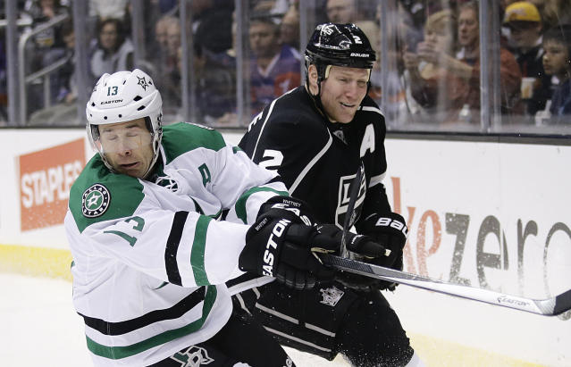 Dallas Stars' Ray Whitney, left, skates past Los Angeles Kings' Matt Greene during the first period of an NHL hockey game on Monday, Dec. 23, 2013, in Los Angeles. (AP Photo/Jae C. Hong)