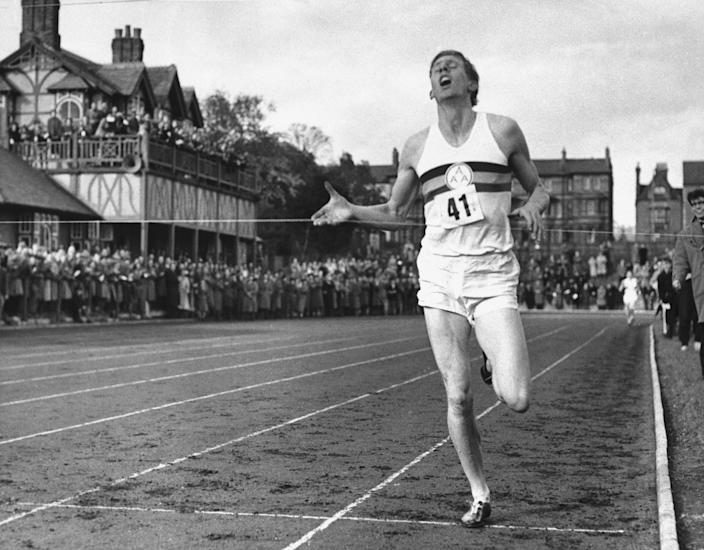 In this May 6, 1954, file photo, British athlete Roger Bannister breaks the tape to become the first man ever to break the four minute barrier in the mile at Iffly Field in Oxford, England.