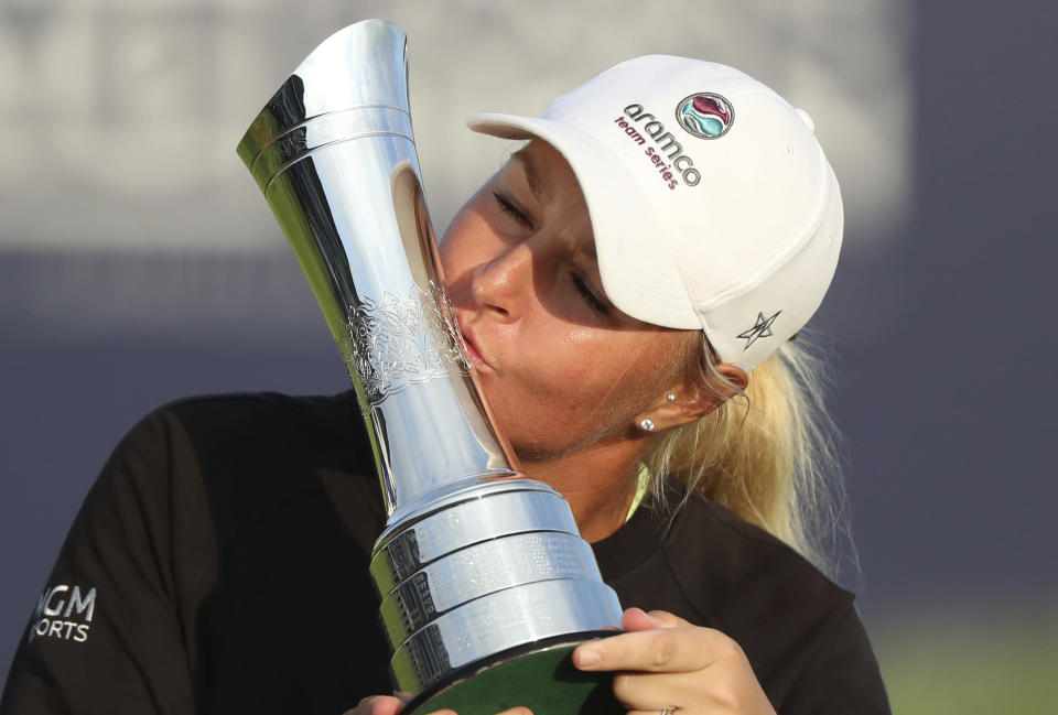 Sweden's Anna Nordqvist kisses the trophy as she poses for the media after winning the Women's British Open golf championship, in Carnoustie, Scotland, Sunday, Aug. 22, 2021. (AP Photo/Scott Heppell)
