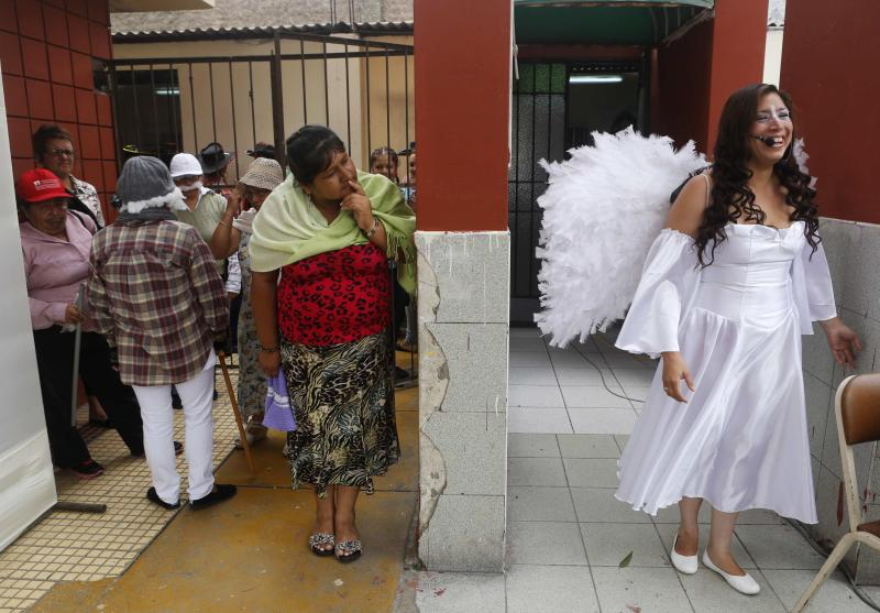 An inmate, dressed as an angel, waits for the start of an event ahead of the International Women's Day at Santa Monica female prison in Lima