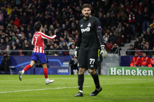 Atletico Madrid's Joao Felix celebrates after scoring the opening goal as Lokomotiv's goalkeeper Anton Kochenkov looks on during the Champions League Group D soccer match between Atletico Madrid and Lokomotiv Moscow at Wanda Metropolitano stadium in Madrid, Spain, Wednesday, Dec. 11, 2019. (AP Photo/Manu Fernandez)