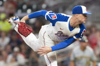 Atlanta Braves relief pitcher Sean Newcomb delivers. in the fourth inning of a baseball game against the Milwaukee Brewers, Friday, July 30, 2021, in Atlanta. (AP Photo/Hakim Wright Sr.)