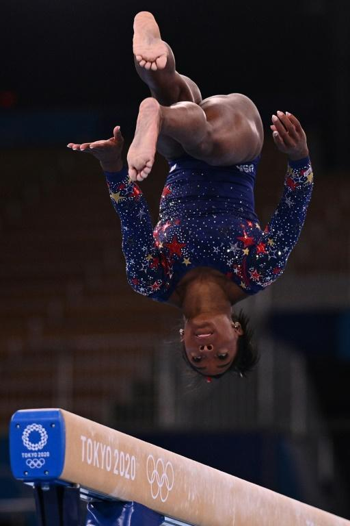 USA's Simone Biles made a shaky start to her Olympic campaign in opening gymnastics qualifiers