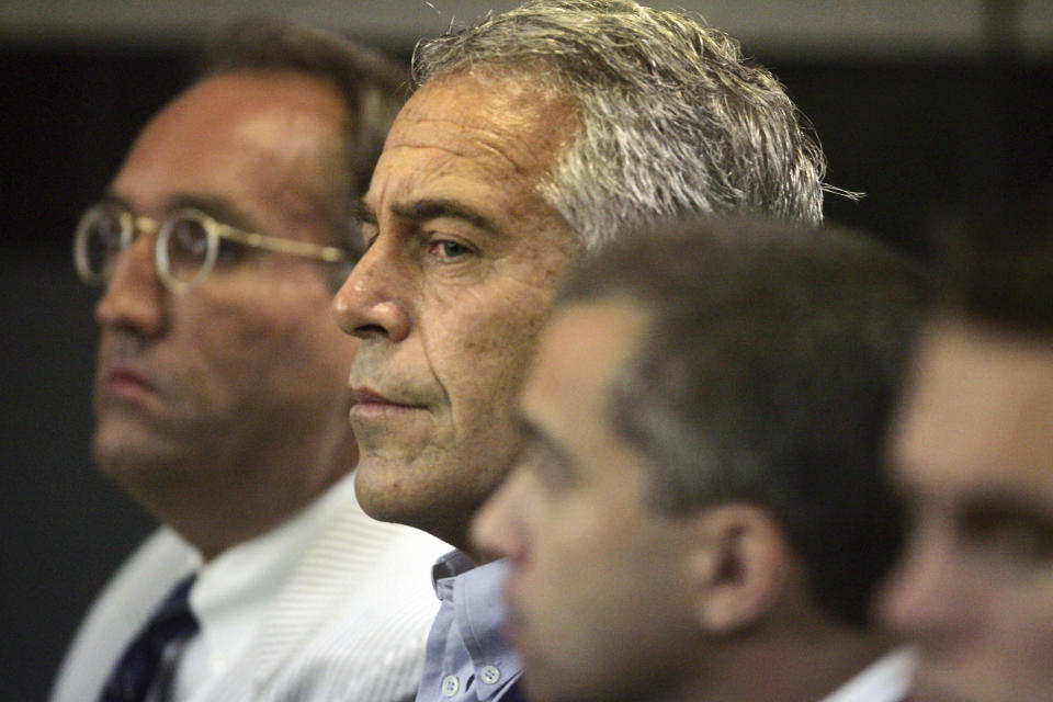 CORRECTS TO EPSTEIN APPEARS IN COURT, NOT IN CUSTODY - FILE - In this July 30, 2008 file photo, Jeffrey Epstein, center, appears in court in West Palm Beach, Fla. The wealthy financier and convicted sex offender has been arrested in New York on sex trafficking charges. Two law enforcement officials said Epstein was taken into federal custody Saturday, July 6, 2019, on charges involving sex-trafficking allegations that date to the 2000s. (Uma Sanghvi/Palm Beach Post via AP, File)