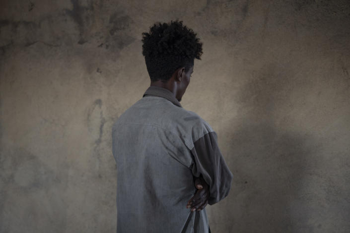 An ethnic Amhara refugee who fled Mai-Kadra, Ethiopia, stands for a portrait inside his temporary shelter in an area separated from Tigray refugees, at Village 8, the transit center near the Lugdi border crossing, eastern Sudan, Sunday, Dec. 6, 2020. Witnesses in Mai-Kadra told the Ethiopian Human Rights Commission and Amnesty International that ethnic Tigrayan forces and allies attacked Amhara. But others say it was the other way around: Tigrayans were targeted by Ethiopian federal forces and allied Amhara regional troops. (AP Photo/Nariman El-Mofty)