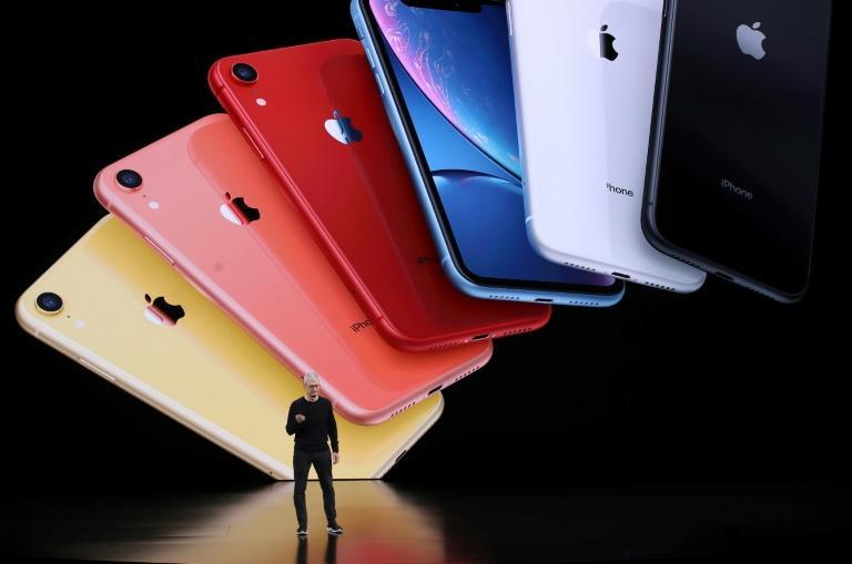 """Apple, whose CEO Tim Cook is seen in 2019, argues that its commission for its App Store is fair compensation for providing a secure storefront, as critics say the marketplace is """"monopolistic"""""""