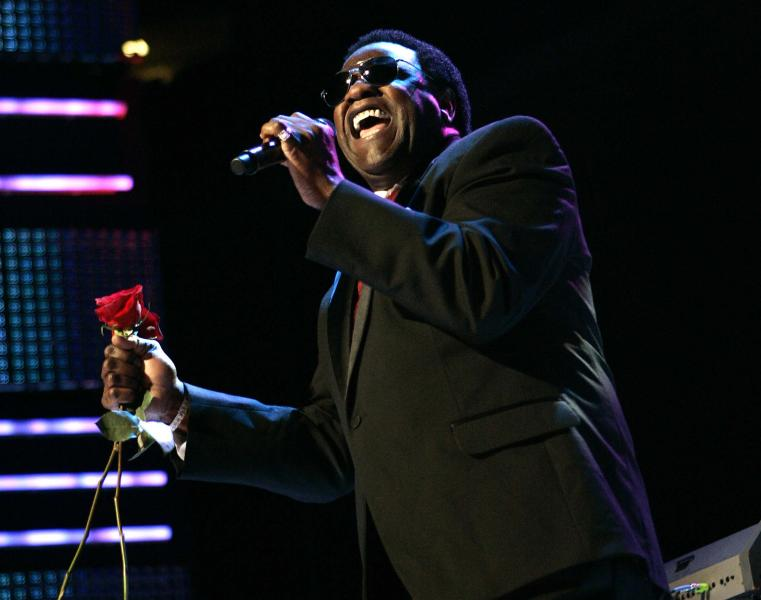 "FILE - This July 5, 2009 file photo shows Al Green performing during the Essence Music Festival in New Orleans. Jennifer Hudson sang Green's classic ""Let's Stay Together,"" at an inaugural ball Monday, Jan. 21, 2013, leaving many to wonder why the soul legend wasn't singing his own hit for President Barack Obama and first lady Michelle Obama. In a statement to The Associated Press, his representative said Green had been asked to sing, but scheduling conflicts prevented him from attending Monday's festivities. Green said he'd be honored to sing for the president in the future. (AP Photo/Patrick Semansky, file)"