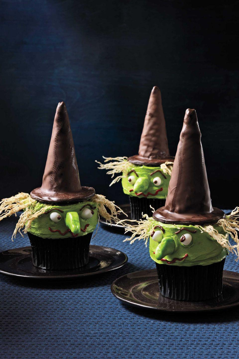 """<p>Put a sugar-coated spell on your guests with these bewitching treats, which elevate homemade vanilla cupcakes with a clever combination of chocolaty store-bought goods, frosting, and candy.<em><br><br><a href=""""https://www.womansday.com/food-recipes/food-drinks/recipes/a11951/witch-cupcakes-recipe-123434/"""" rel=""""nofollow noopener"""" target=""""_blank"""" data-ylk=""""slk:Get the Witchy Cupcakes recipe."""" class=""""link rapid-noclick-resp"""">Get the Witchy Cupcakes recipe.</a></em></p>"""