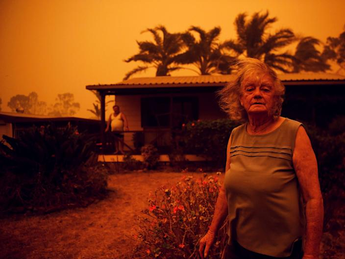 Nancy Allen and Brian Allen stand outside the house as high winds push smoke and ash from the Currowan Fire towards Nowra, New South Wales, Australia January 4, 2020. REUTERS/Tracey Nearmy