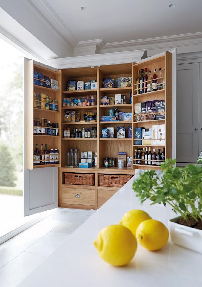 "<p>In a soft oak, this larder brings in an element of warmth, while also providing plenty of storage. With more shelves than you can count, you'll never run out of space for all of those jars. <br></p><p>•  See more from <a href=""https://www.tomhowley.co.uk/"" target=""_blank"">Tom Howley</a></p><p><strong>DISCOVER MORE</strong>: <a href=""https://www.housebeautiful.com/uk/garden/a26747986/feed-birds-leftover-food/"" target=""_blank"">8 kitchen scraps that are safe to feed the birds</a></p>"