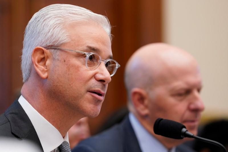 FILE PHOTO: Charles W. Scharf, chairman & CEO of the Bank of New York Mellon, testifies before a House Financial Services Committee hearing on Capitol Hill in Washington
