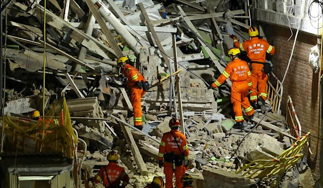 The Urban Search and Rescue team of the Fire Services Department inspect the collapse of a an outer wall of the Married Inspectors' Quarters in May 2016. Photo: Edmond So
