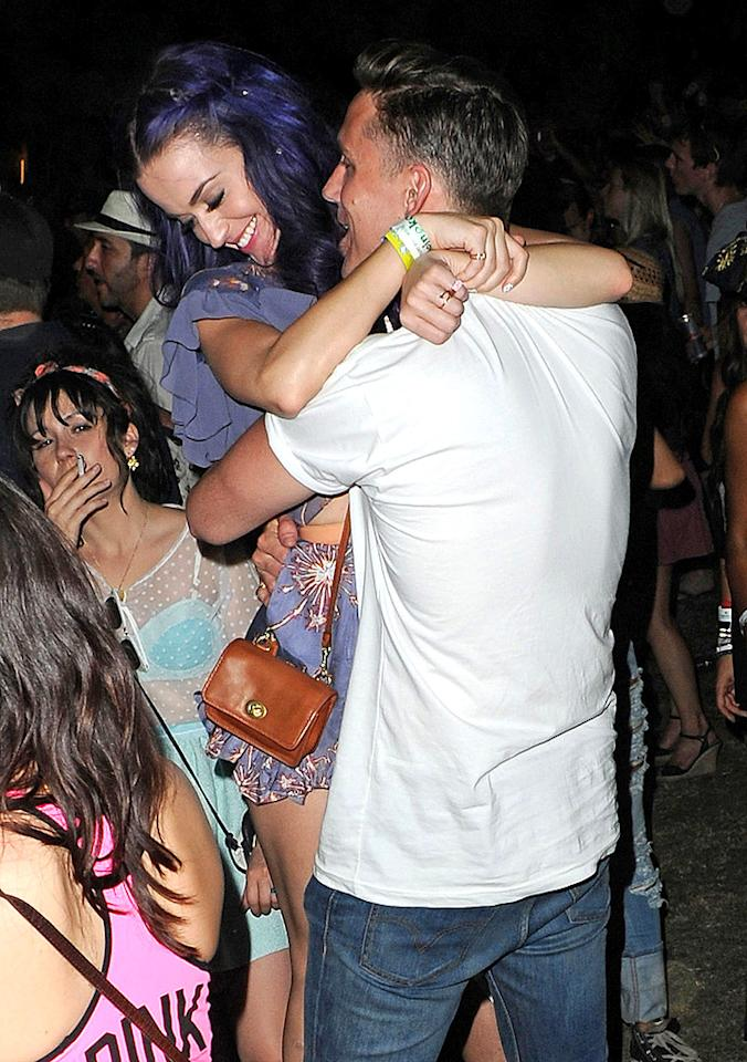 "When Katy Perry's year-long marriage to Russell Brand came to an abrupt end in December 2011, she didn't exactly sit home longingly reciting the lyrics to her song ""The One That Got Away."" Nope. Our favorite ""California Gurl"" shifted her attention to someone new: Rob Ackroyd. At the Coachella Music Festival in April 2012, she seemed much more interested in the Florence + the Machine guitarist than any of the bands on stage. Their weekend was PDA-packed! For the next couple months, Ackroyd appeared to be a fun distraction for Perry, but things fizzled out in July … perhaps because of another tattooed guitar player. John Mayer, anyone?"