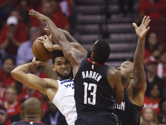 James Harden and P.J. Tucker provided swarming defense Wednesday night. (Brett Coomer/Houston Chronicle via AP)