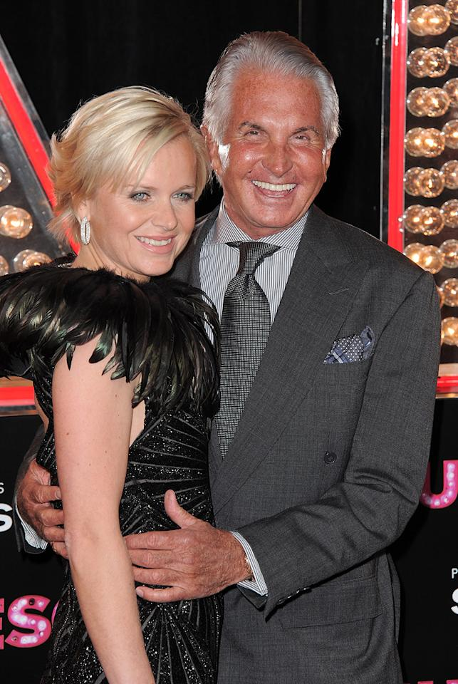 """<a href=""""http://movies.yahoo.com/movie/contributor/1800054509"""">George Hamilton</a> and guest at the Los Angeles premiere of <a href=""""http://movies.yahoo.com/movie/1810125282/info"""">Burlesque</a> on November 15, 2010."""