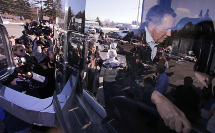 <p>Republican presidential candidate Ohio Gov. John Kasich climbs aboard his campaign bus after a stop at Nashua Community College, Feb. 7, 2016. <i>(Photo: Charles Krupa/AP)</i></p>