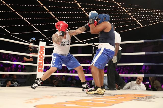 <p>Mike Cintron (red) of the 23rd Precinct in Manhattan knocks back Edgar Duncan of the 42nd Precinct in the Bronx (blue) in the Manhattan North vs. Bronx bout during the NYPD Boxing Championships at Madison Square Garden's Hulu Theater on March 15, 2018. (Gordon Donovan/Yahoo News) </p>