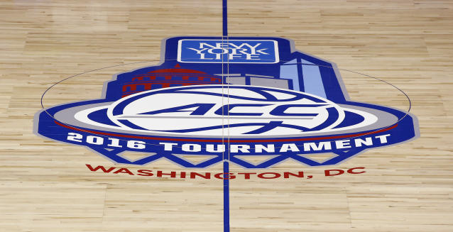 The NCAA college basketball Atlantic Coast Conference tournament series logo is displayed Monday, March 7, 2016, at center court in Verizon Center in Washington. (AP Photo/Alex Brandon)