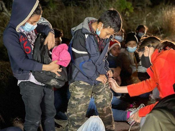PHOTO: ABC News' Cecilia Vega speaks with two young boys who were traveling alone while attempting to reach relatives in the United States, at the U.S. Border in March 2021. (Ignacio Torres/ABC News)