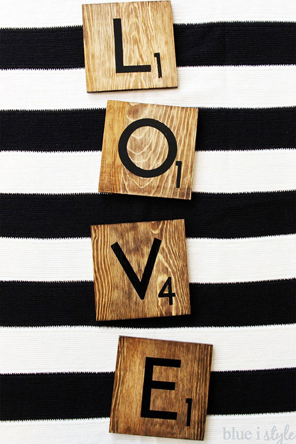 """<p>How do you spell L-O-V-E? With these giant Scrabble coasters. Use a stain marker to get the depth of color and texture on the wood pieces. </p><p><strong>Get the tutorial at <a href=""""http://www.blueistyleblog.com/2015/01/ValentinesScrabbleLoveCoasters.html"""" rel=""""nofollow noopener"""" target=""""_blank"""" data-ylk=""""slk:Blue I Style"""" class=""""link rapid-noclick-resp"""">Blue I Style</a>.</strong> </p><p><strong><a class=""""link rapid-noclick-resp"""" href=""""https://www.amazon.com/Unfinished-Square-Crafting-Altered-Embellishing/dp/B00DC1WQQA/?tag=syn-yahoo-20&ascsubtag=%5Bartid%7C10050.g.2971%5Bsrc%7Cyahoo-us"""" rel=""""nofollow noopener"""" target=""""_blank"""" data-ylk=""""slk:SHOP SQUARES"""">SHOP SQUARES</a><br></strong></p>"""